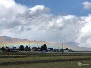 季節限定の低い虹が出現 天気は目まぐるしく変化