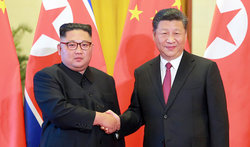 画像:「朝鮮の戦略的路線を断固支持」習近平氏が金正恩氏に答電